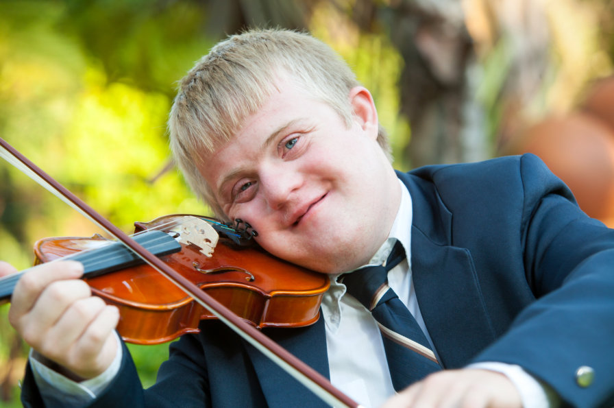 A boy playing his violin